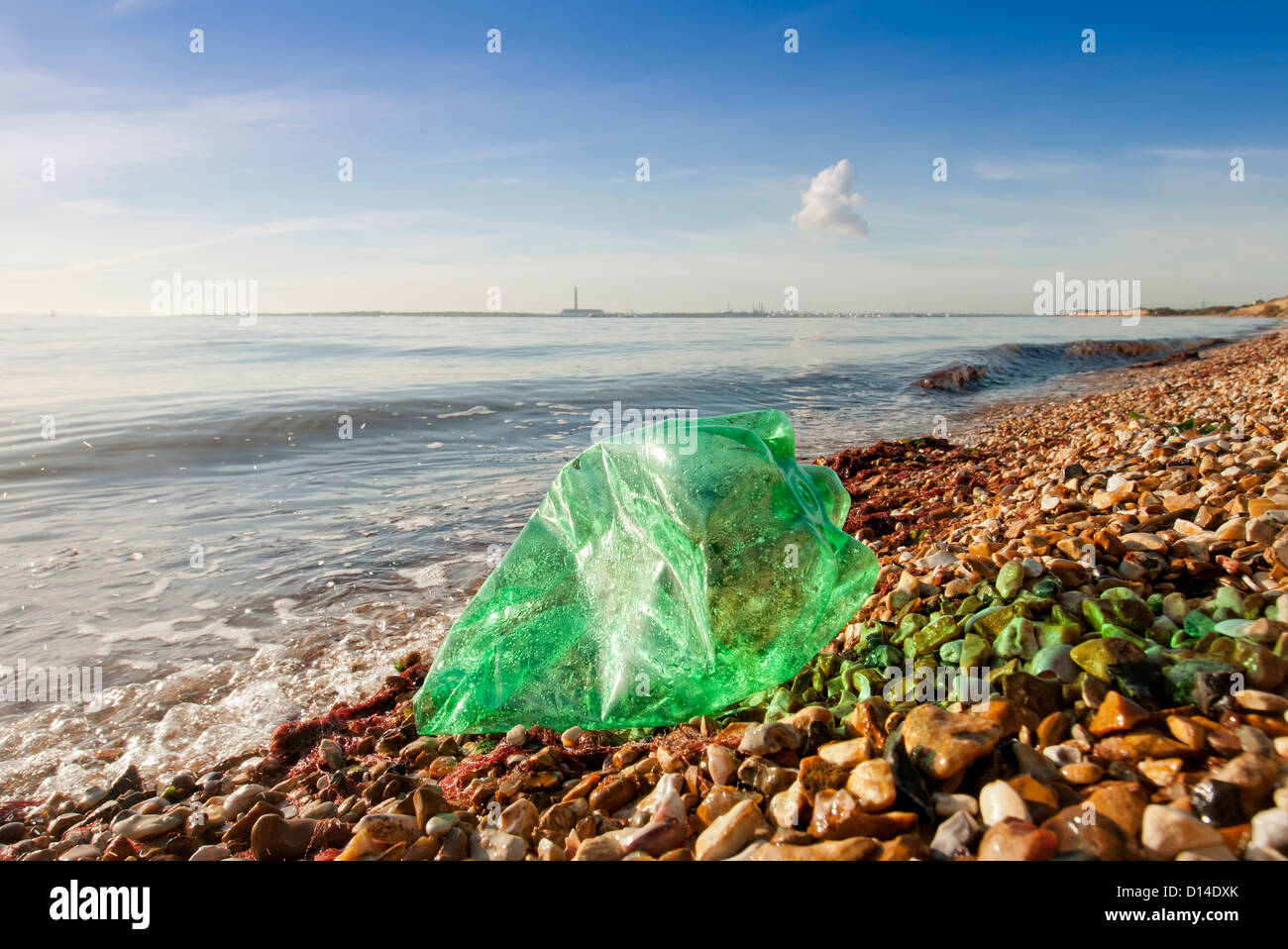 plastic bottle washed up onto a beach, coastal pollution - Stock Image