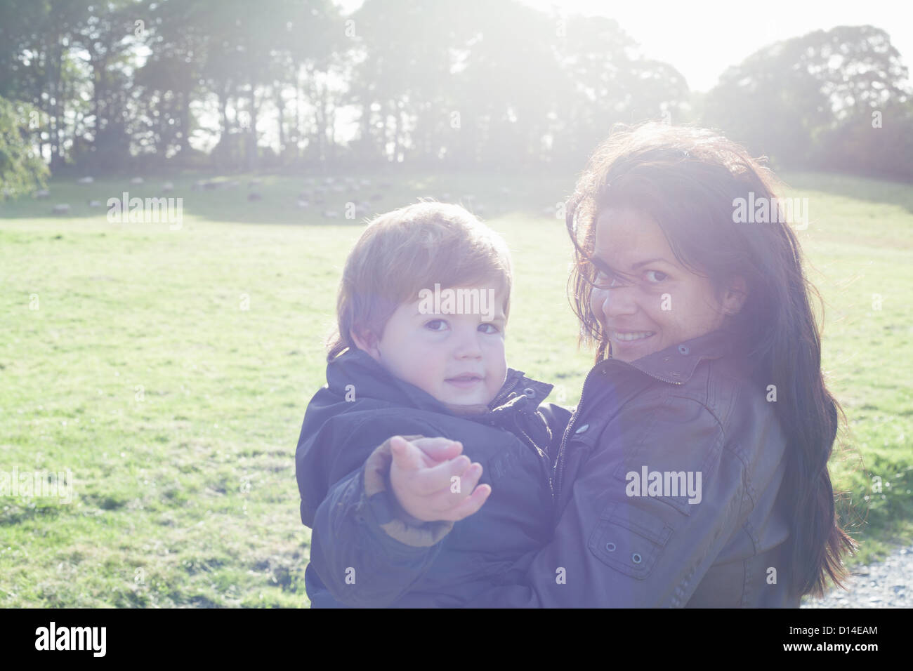 Mother holding son outdoors Stock Photo