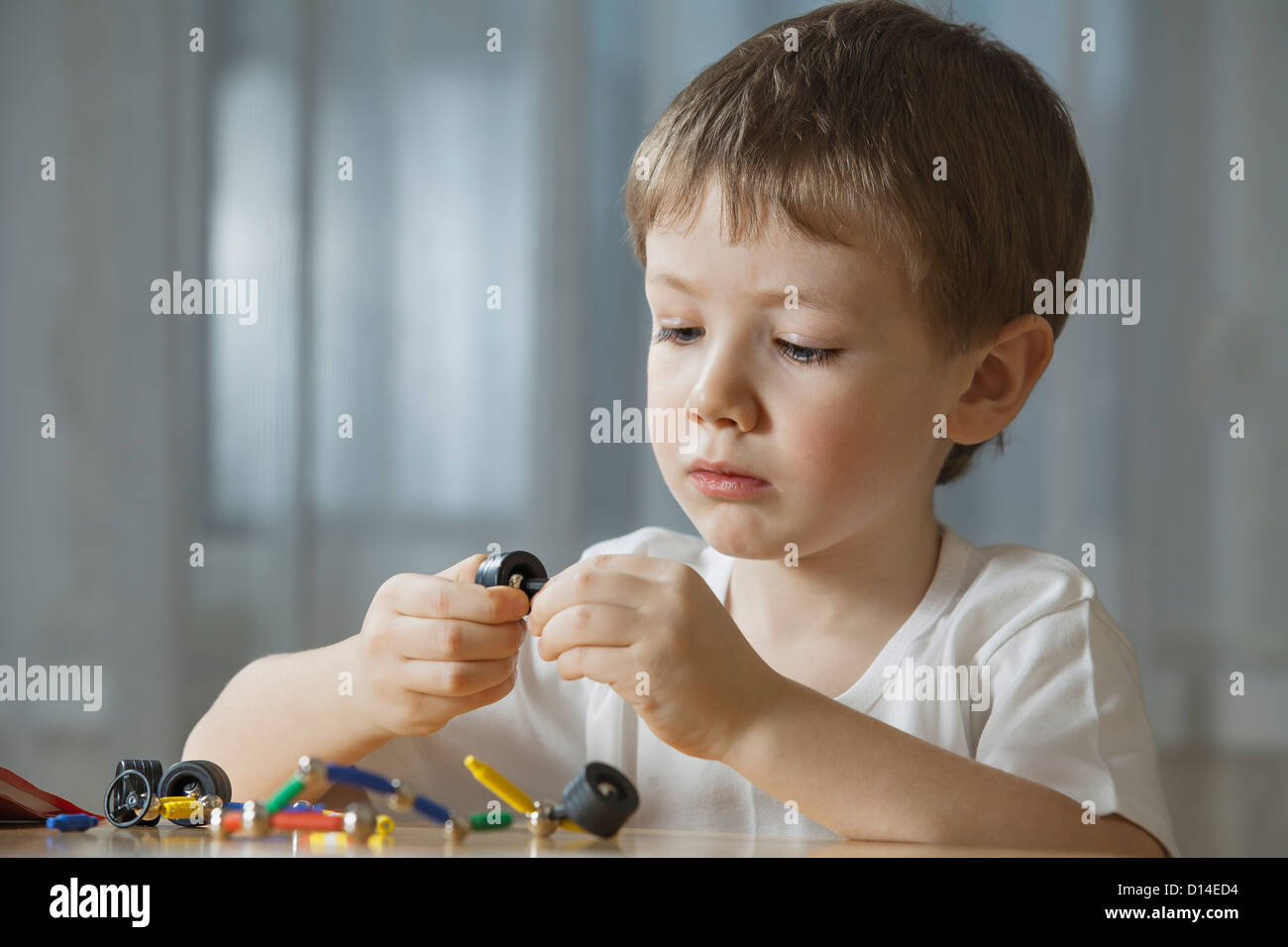 young boy playing with shape game Stock Photo