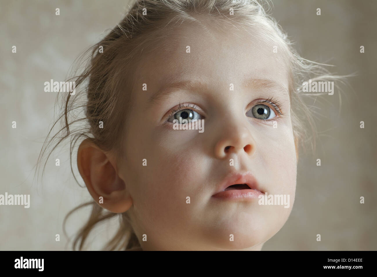 portrait of young girl looking astonished - Stock Image