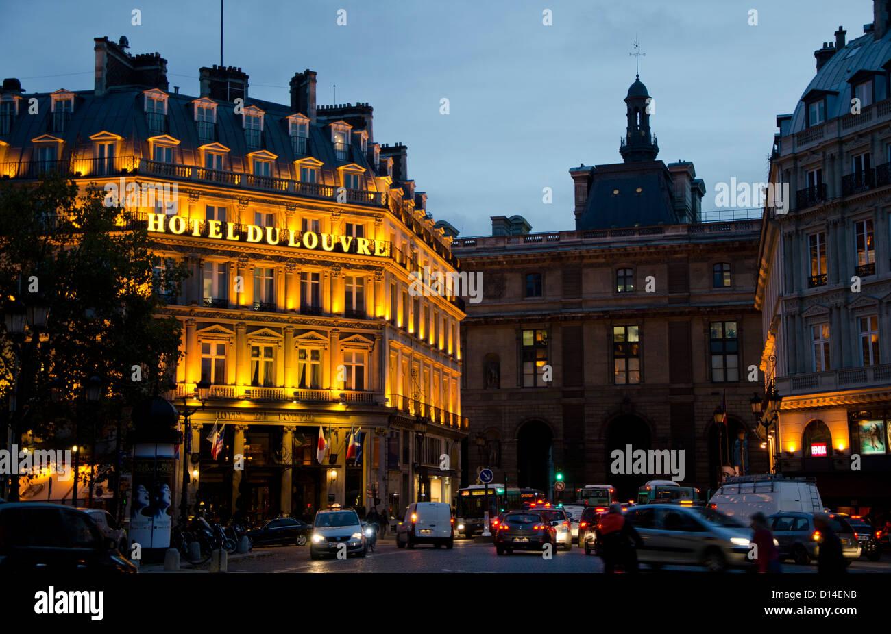 Grand Hotel du louvre at Place du Palais-Royal at night, Paris. Ile-de-France, Paris, France. - Stock Image