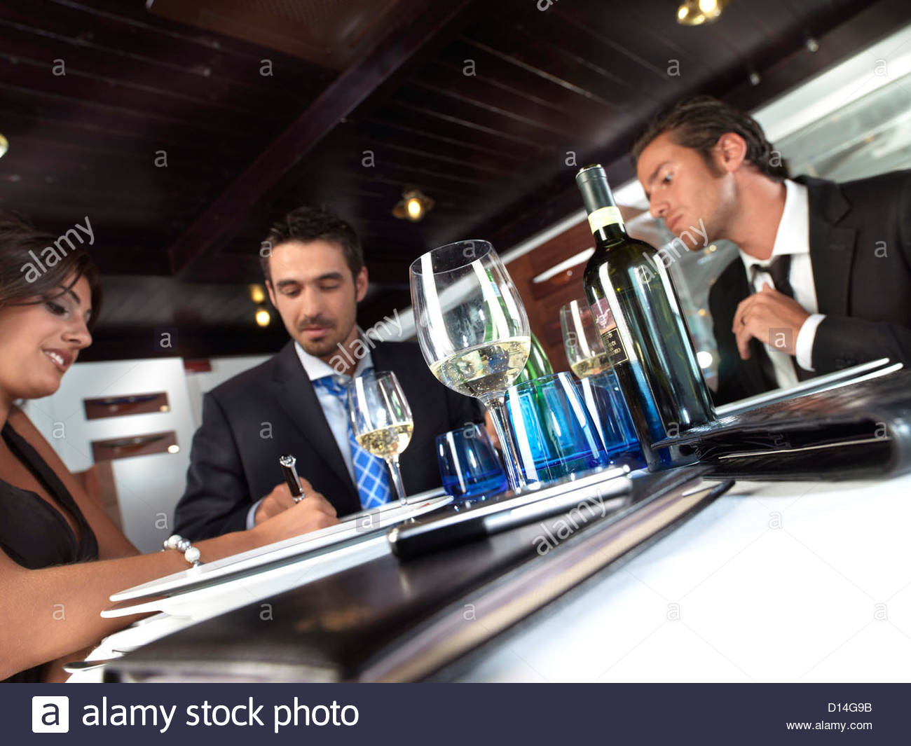 businesspeople sitting at restaurant Stock Photo