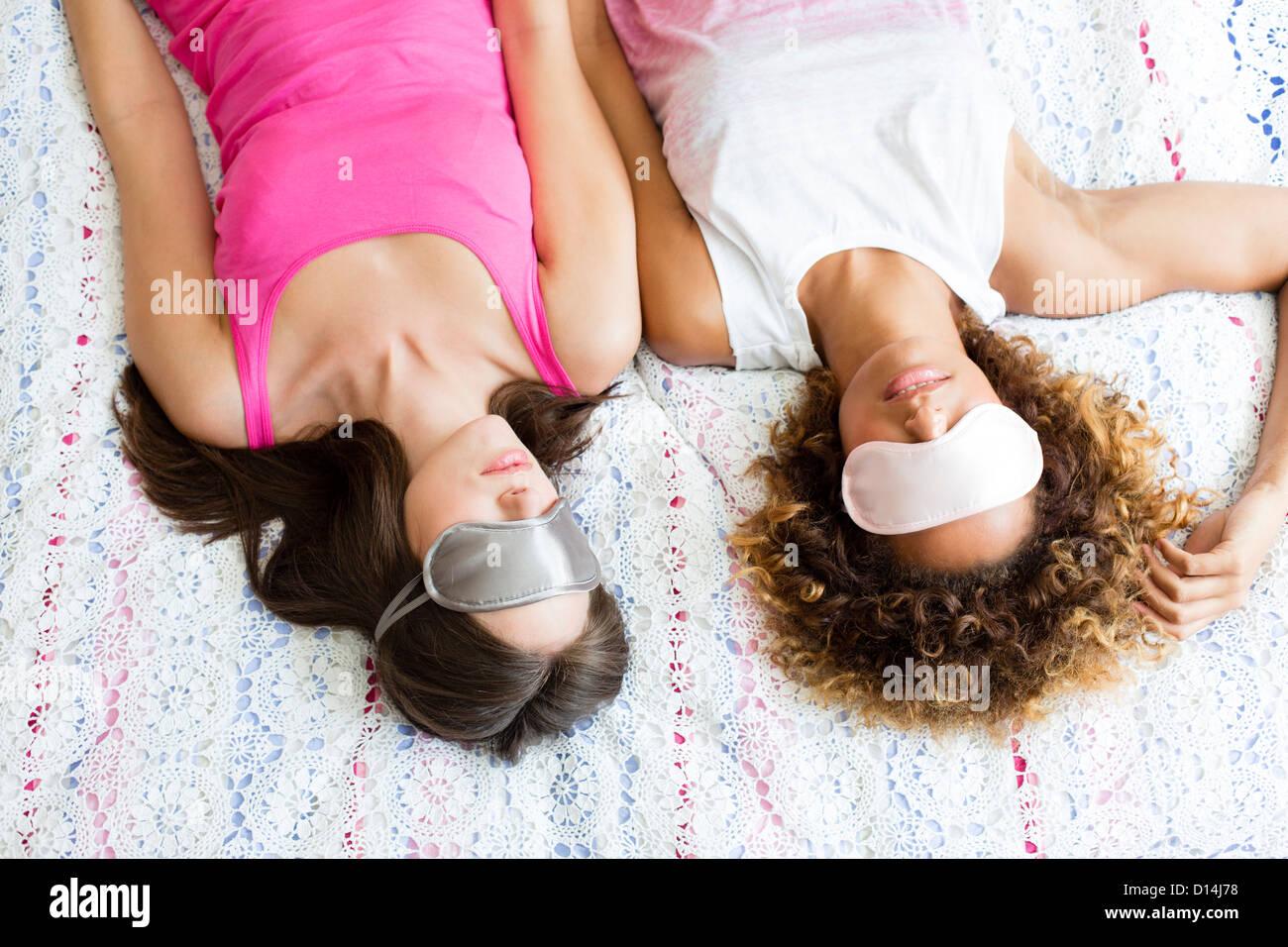 Sleeping woman wearing face masks - Stock Image