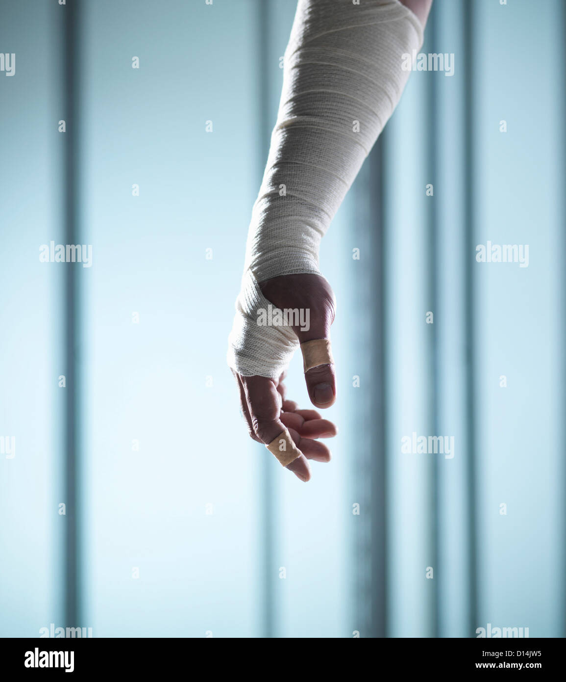 Close up of hand covered in bandages - Stock Image