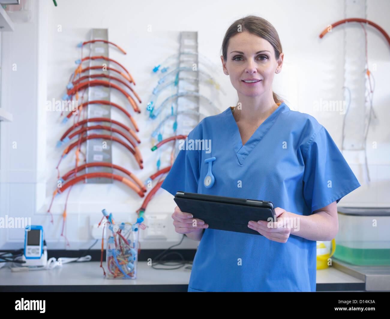 Veterinarian using tablet computer Stock Photo