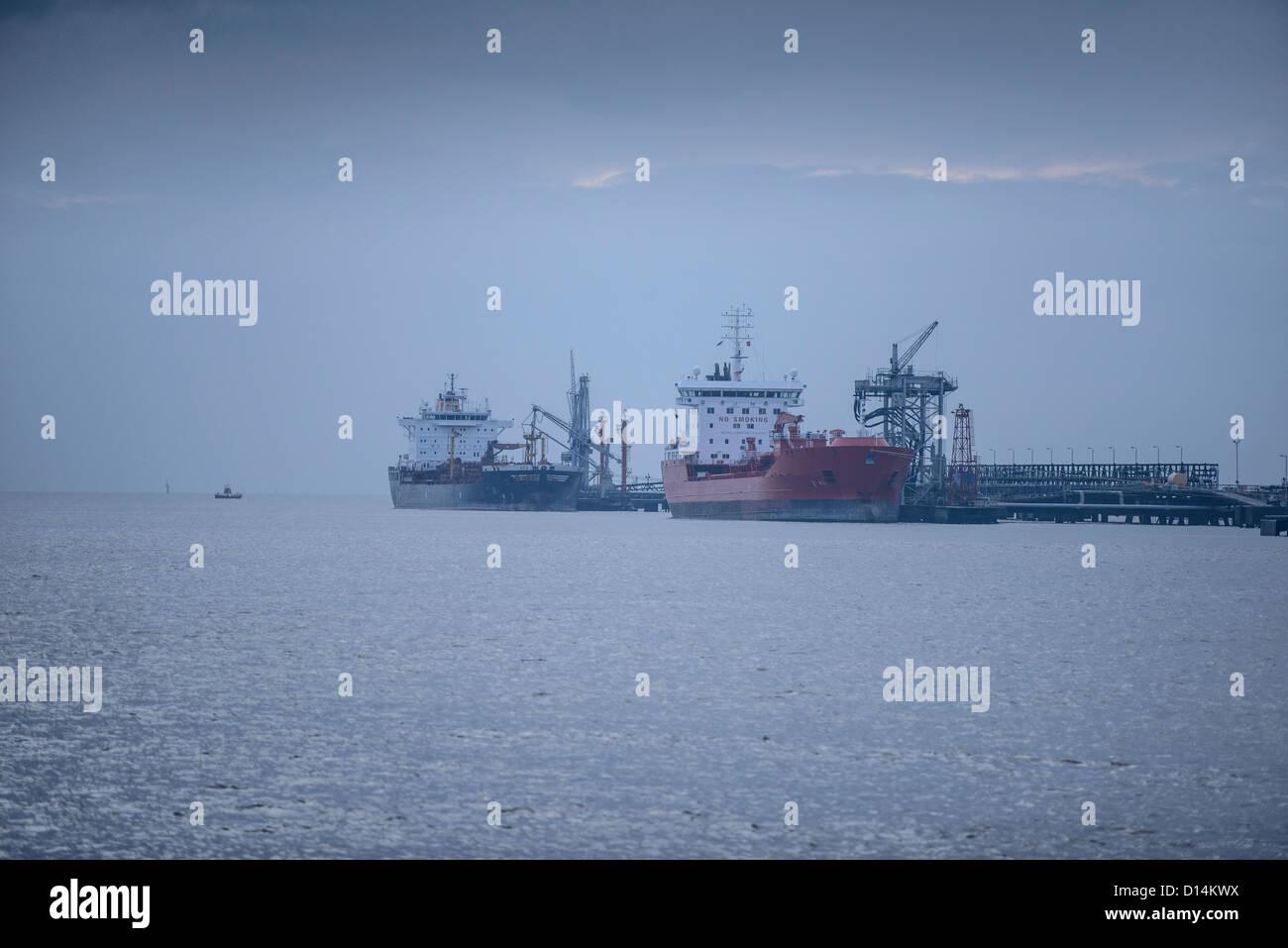 Oil tankers at sea terminal - Stock Image