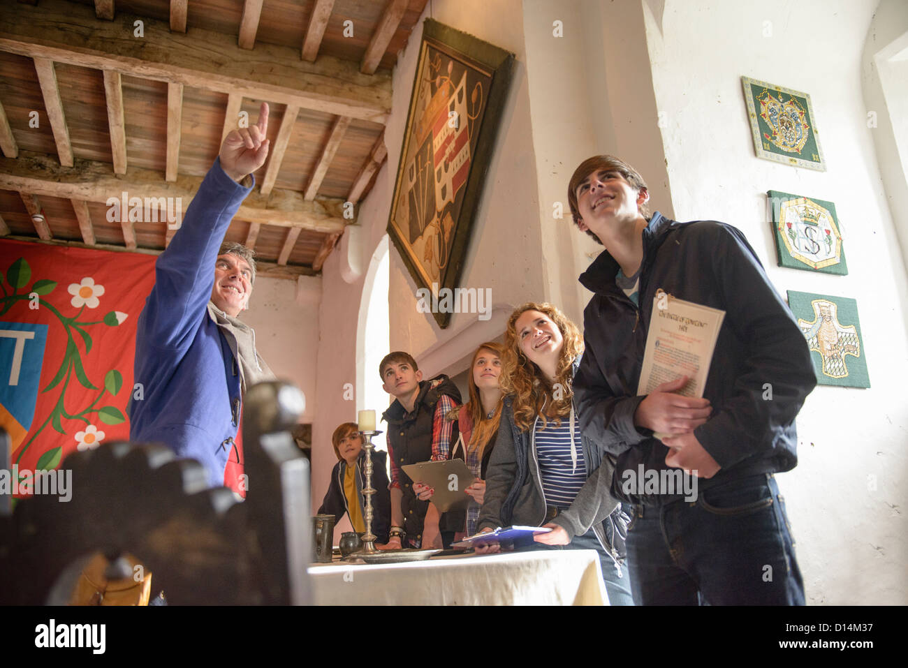 Students examining medieval castle - Stock Image