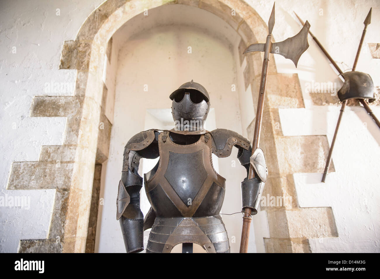 Suit of armor wearing sunglasses - Stock Image