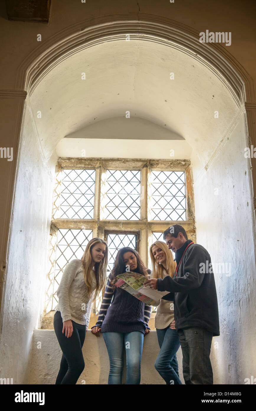 Students reading map in castle - Stock Image