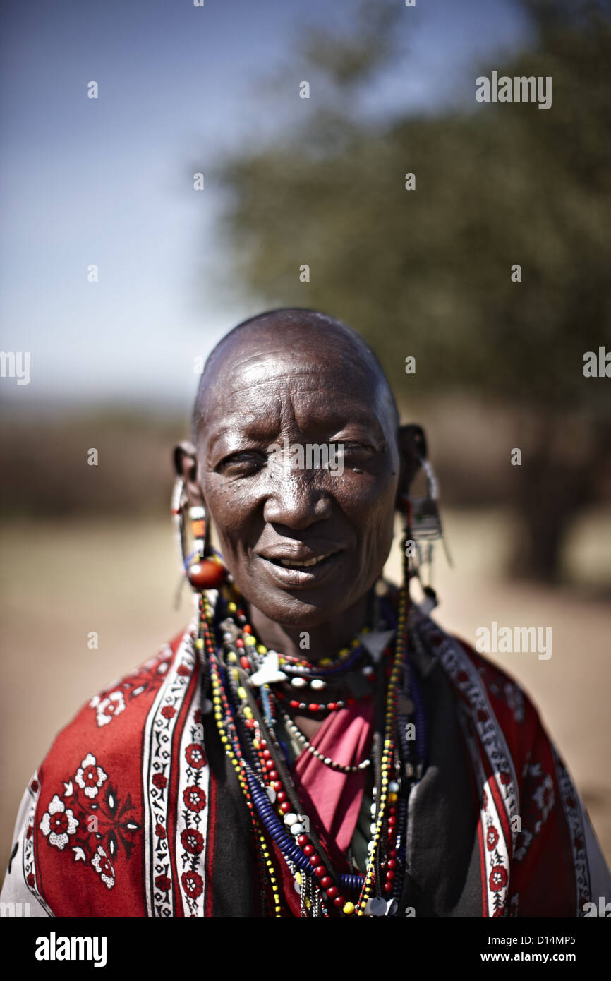 Smiling Maasai woman wearing jewelry - Stock Image