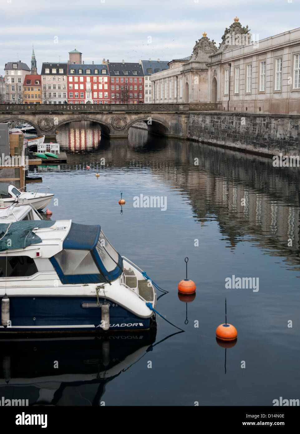 Looking along Frederiksholms Kanal towards the inner city, with Nybrogade at the horizon and Christiansborg Palace - Stock Image
