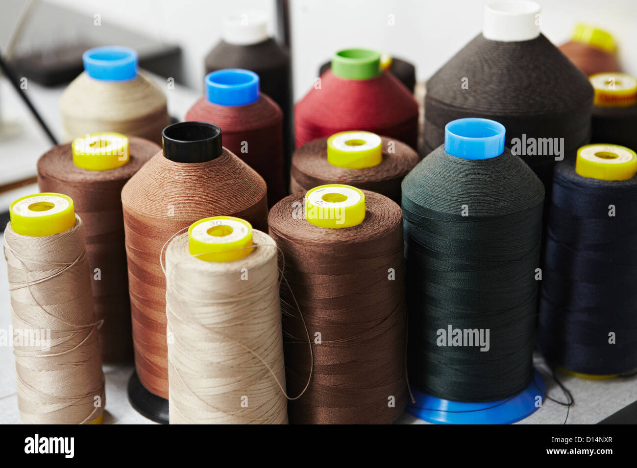 Spools of colored thread - Stock Image