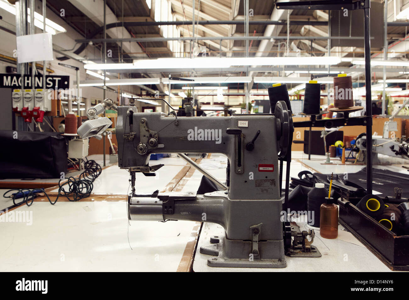 Sewing machine in clothing factory - Stock Image