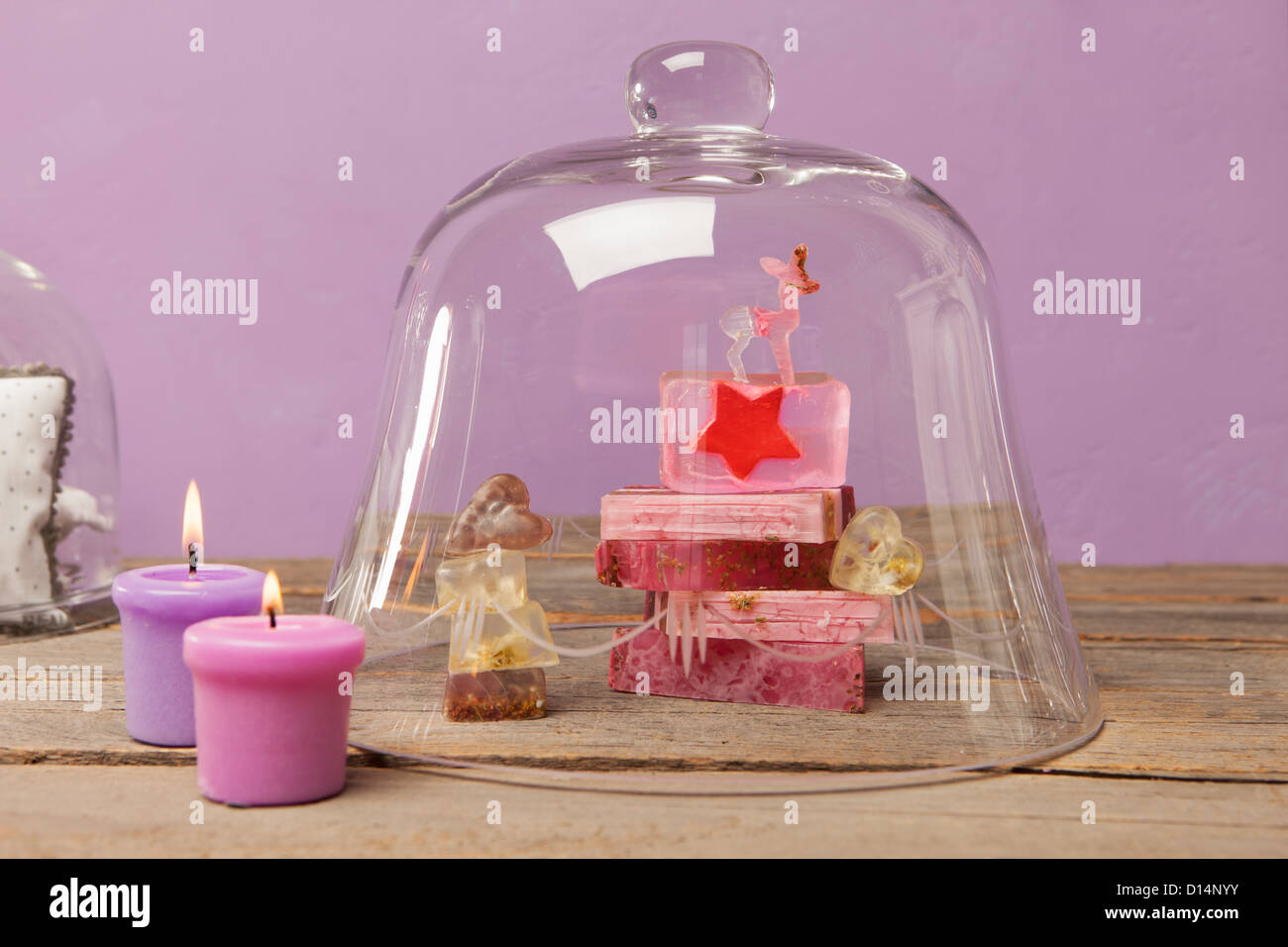 Bars of soap and candles with bell jar - Stock Image