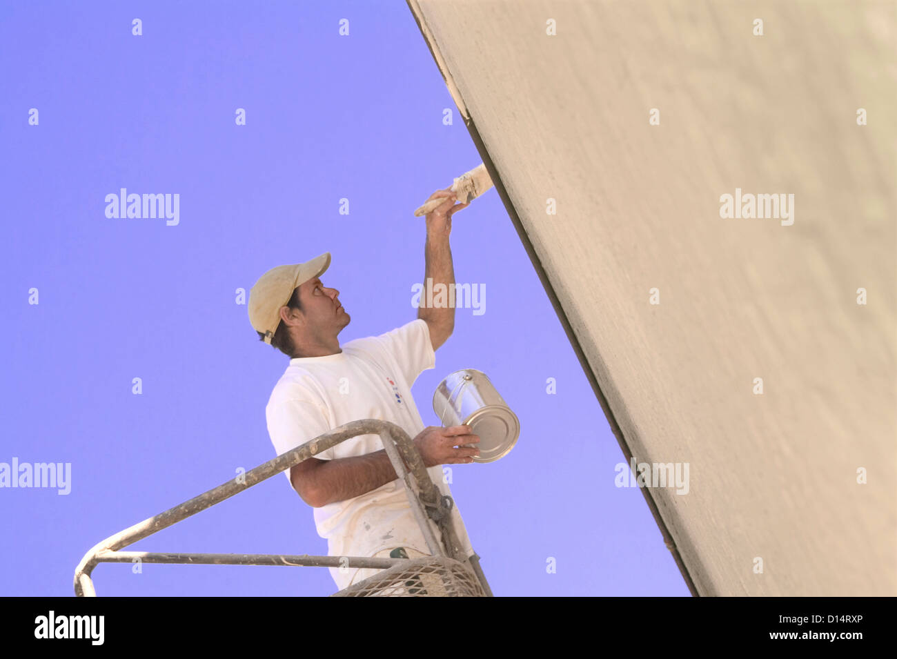 Painter Painting Outside Of Building - Stock Image