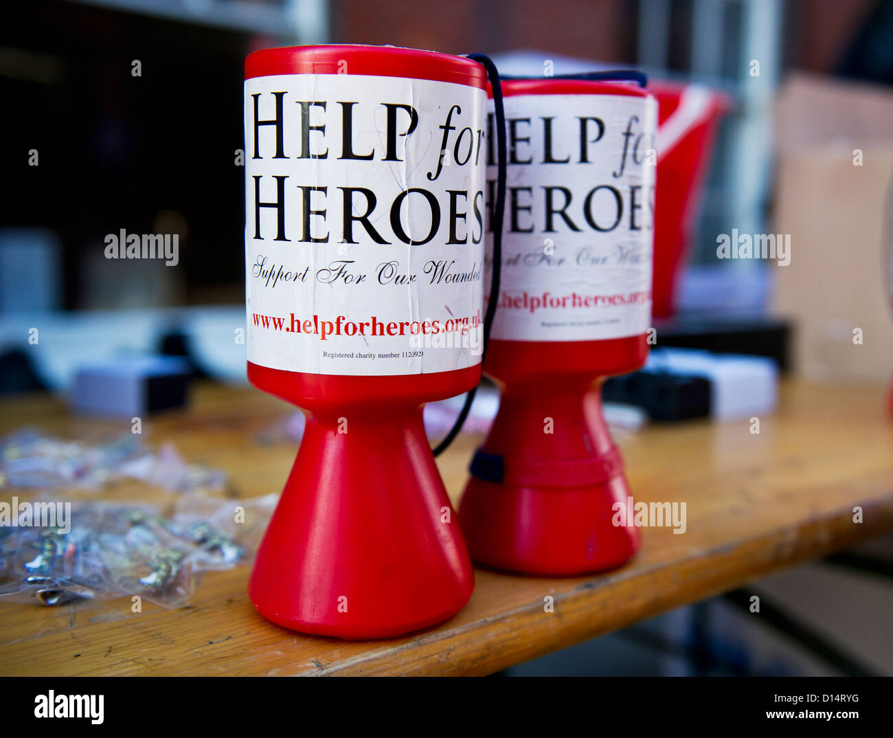 Collecting boxes for Help for Heroes charity. - Stock Image
