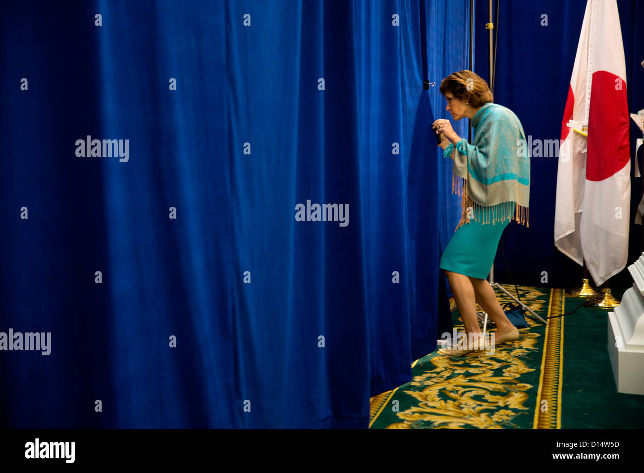 US Chief of Protocol Capricia Marshall peeks through the curtain to check on the progress of the bilateral meeting - Stock Image