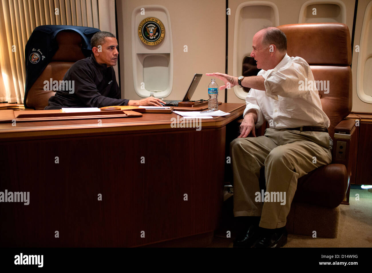 US President Barack Obama talks with National Security Advisor Tom Donilon before a phone call with President Mohammed - Stock Image