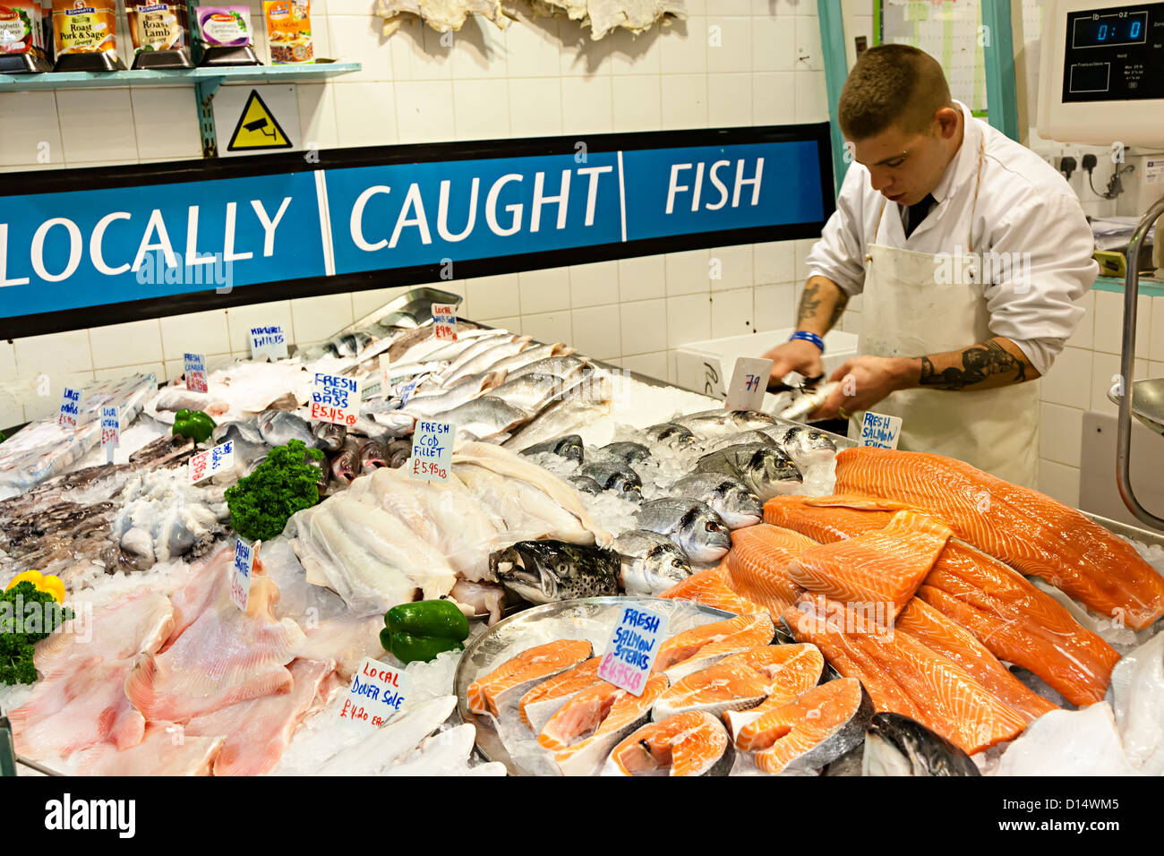 Locally caught fish on sale on fishmongers stall, indoor market, St Helier, Jersey, Channel island, UK - Stock Image