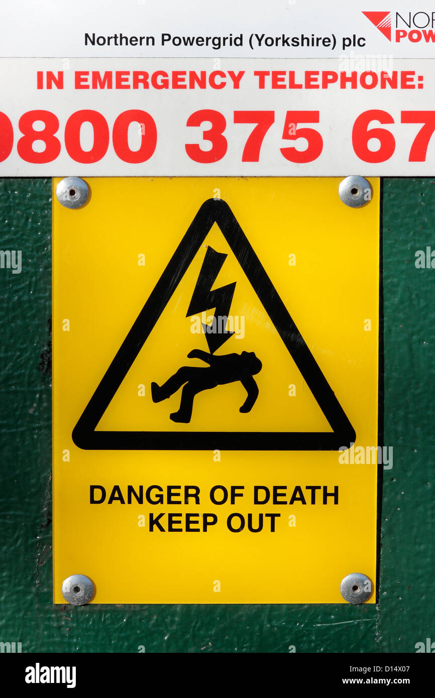 Danger of Death Keep Out Sign on an electrical power grid distribution cubicle. - Stock Image