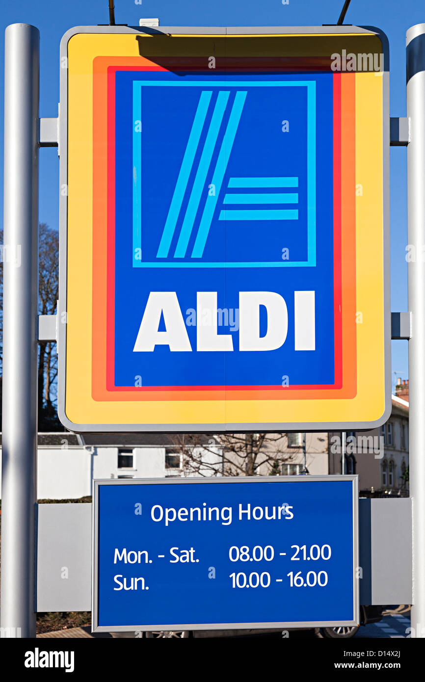 Aldi supermarket sign with opening hours, Abergavenny, Wales, UK - Stock Image