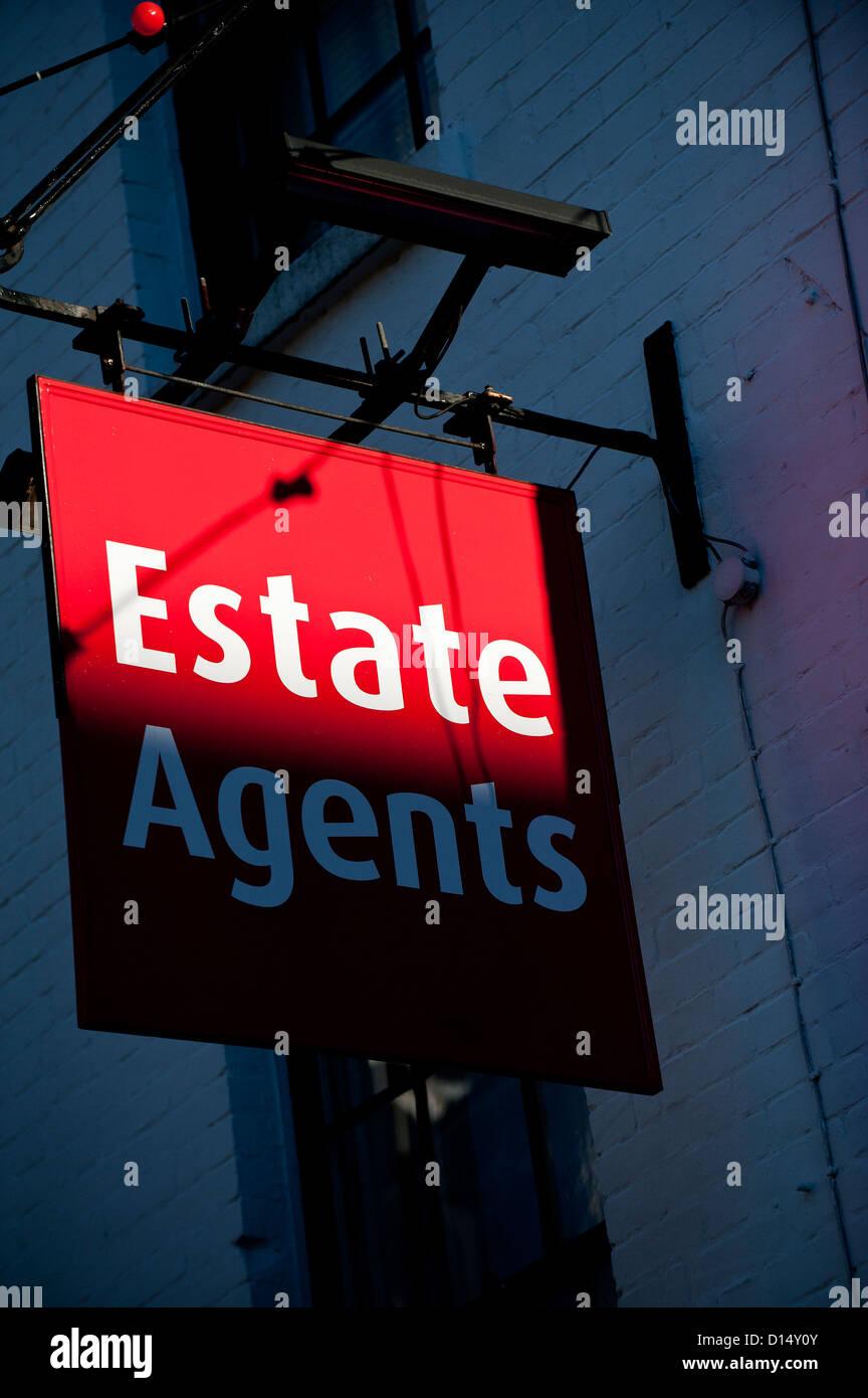 Sunlight illuminating an estate agent sign. - Stock Image