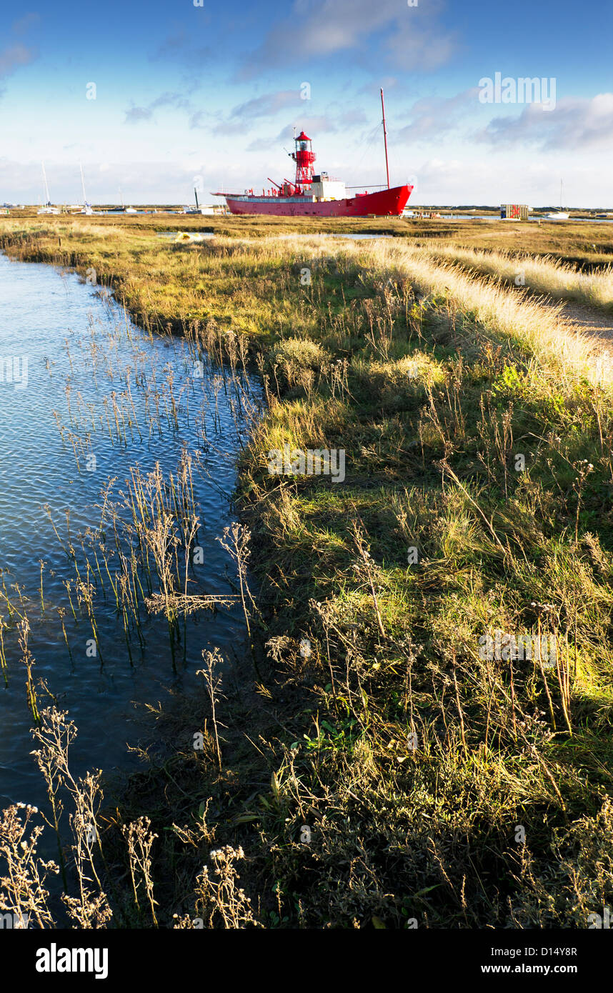 The retired lightship Trinity moored at Tollesbury Saltmarsh in Essex. - Stock Image