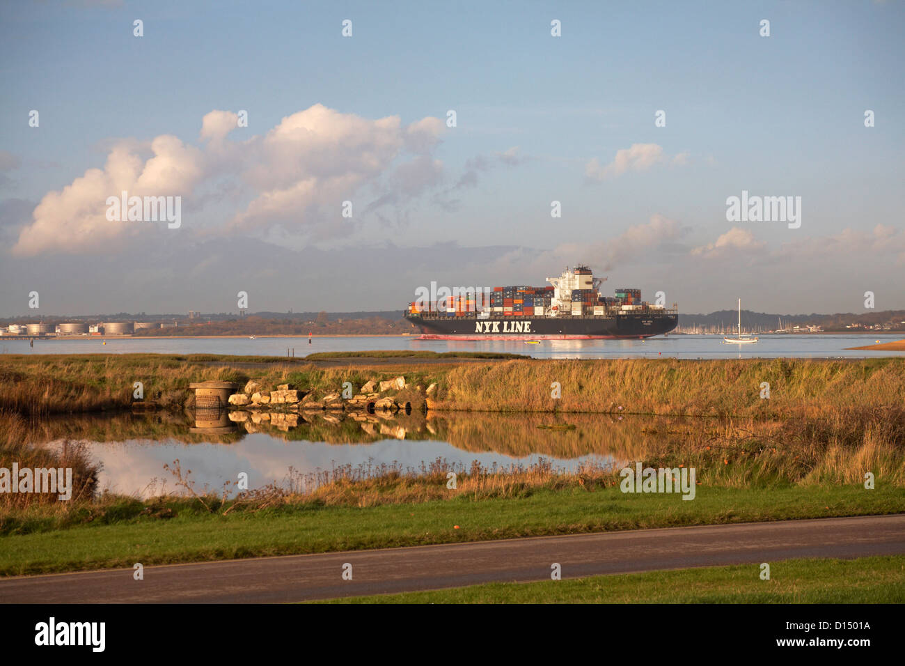 Container ship NYK Line sailing into Southampton at Calshot Hampshire in November - Stock Image