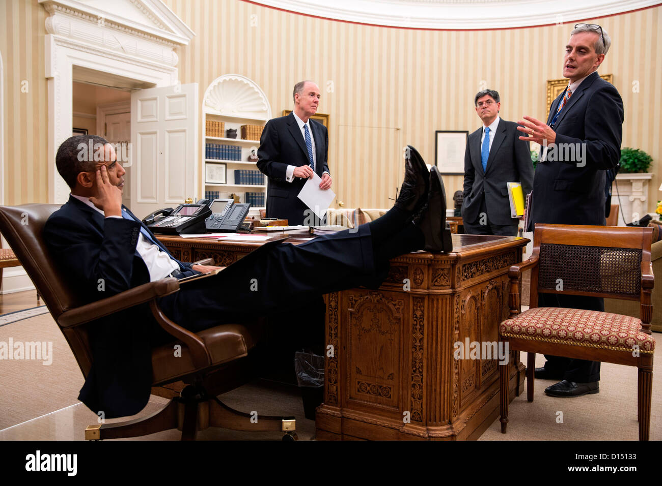President Barack Obama meets with National Security Advisor Tom Donilon, Chief of Staff Jack Lew, and Deputy National - Stock Image