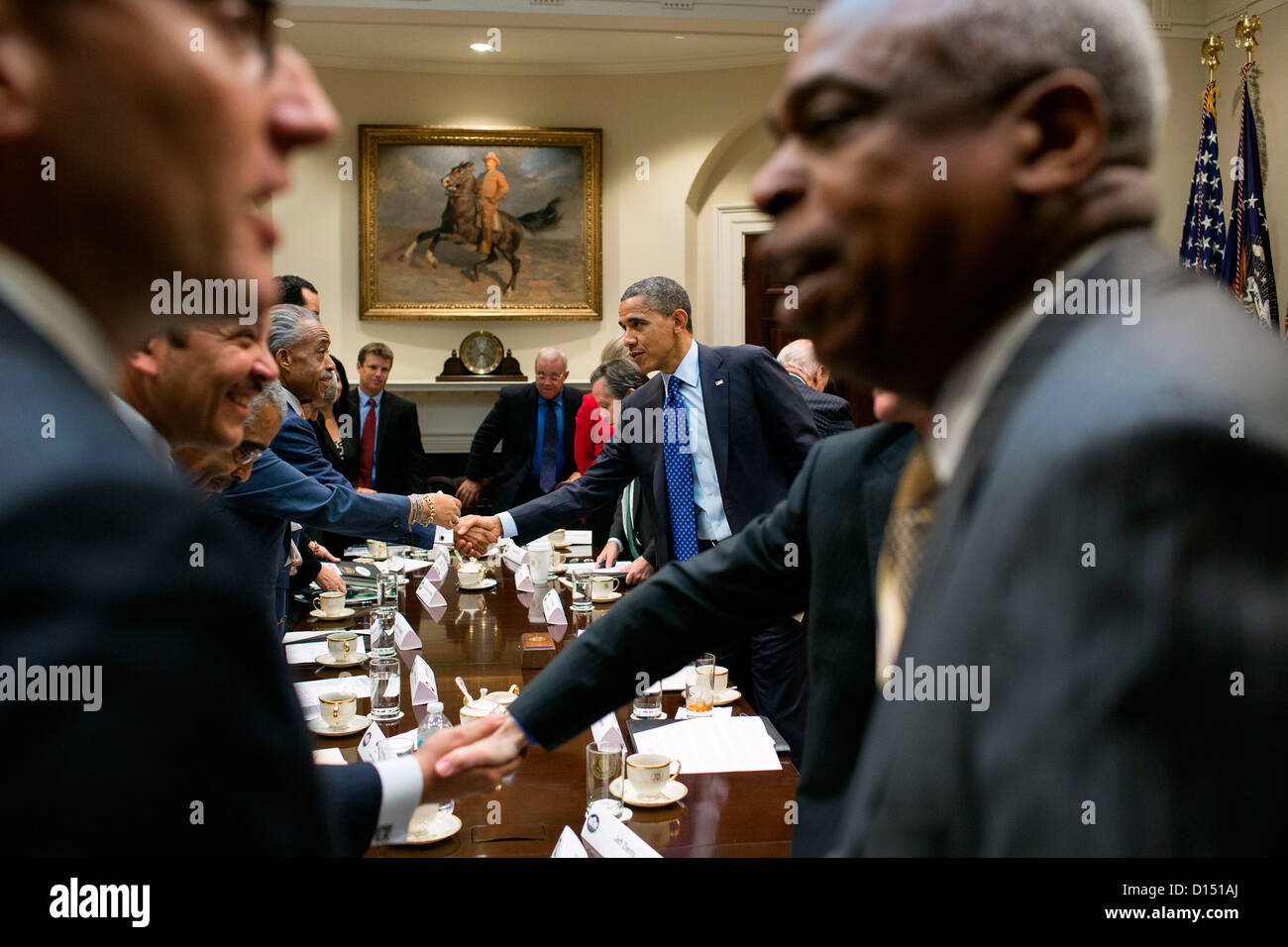 US President Barack Obama shakes hands with civic and constituency leaders to during a meeting in the Roosevelt - Stock Image