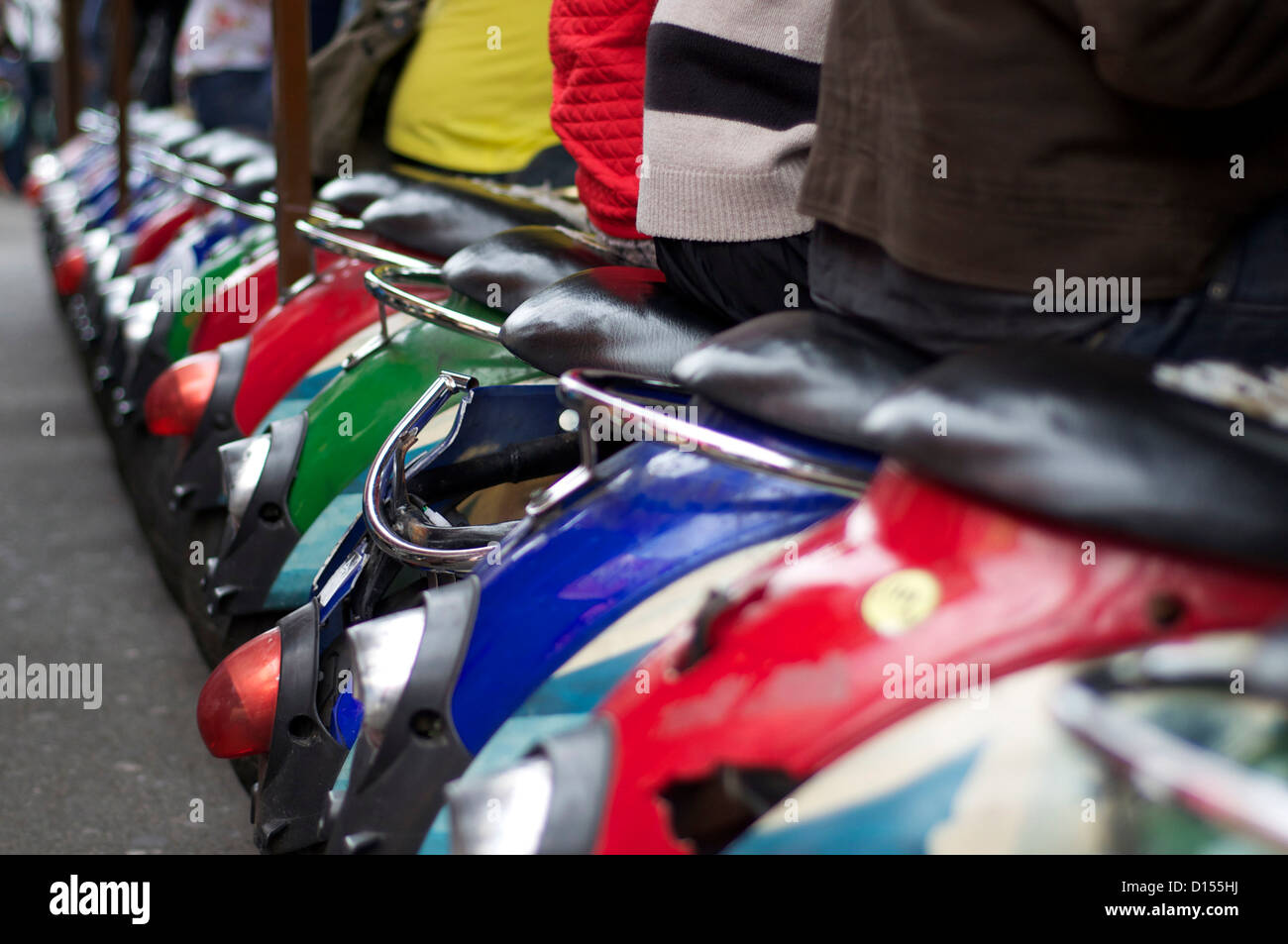 A row of mopeds lined up at a Camden market restaurant - Stock Image