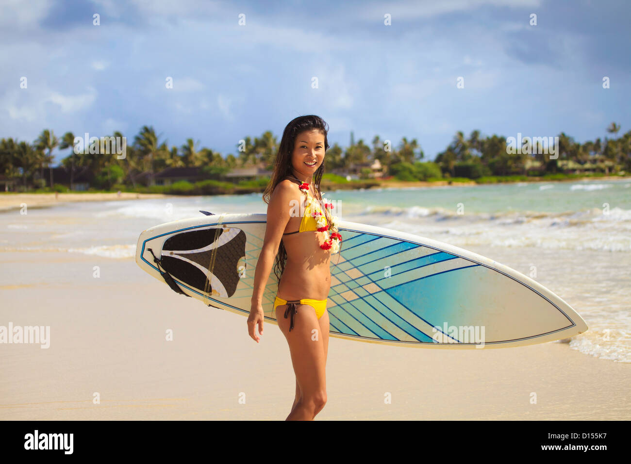 Hawaii Oahu Young Woman Poses With Her Surfboard About To