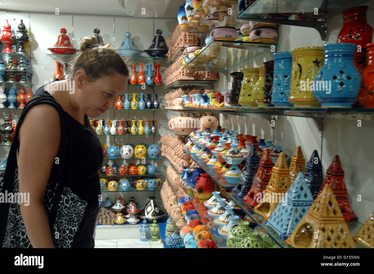 A holidaymaker shopping for gifts in Tunisia. - Stock Image