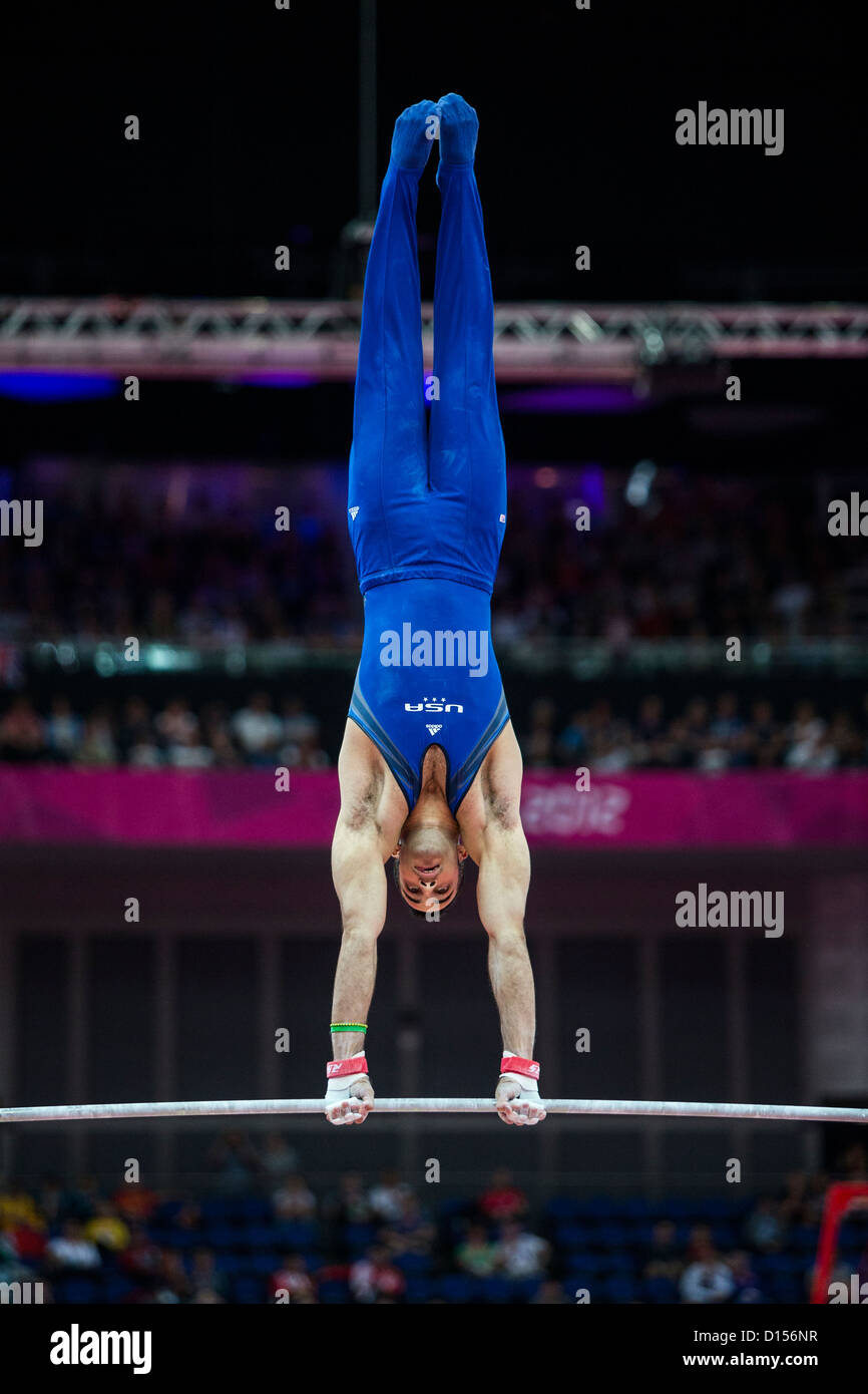 Danell Leyva (USA) competing on the Horizontal Bar during the men's team gymnastics qualification at the 2012 - Stock Image