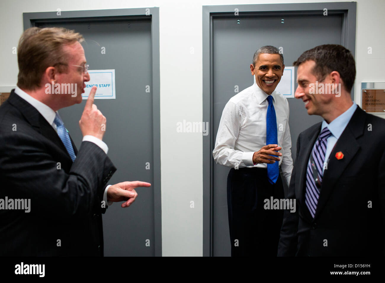 US President Barack Obama jokes with Robert Gibbs and David Plouffe backstage prior to the start of the third presidential - Stock Image