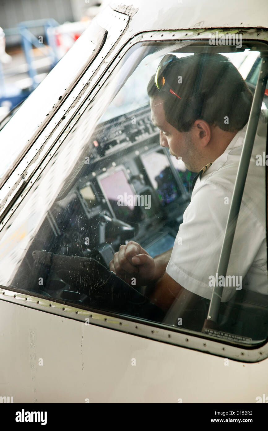 Captain of Aeromexico Connect airplane photographed through cockpit window before flight between Mexico City & - Stock Image