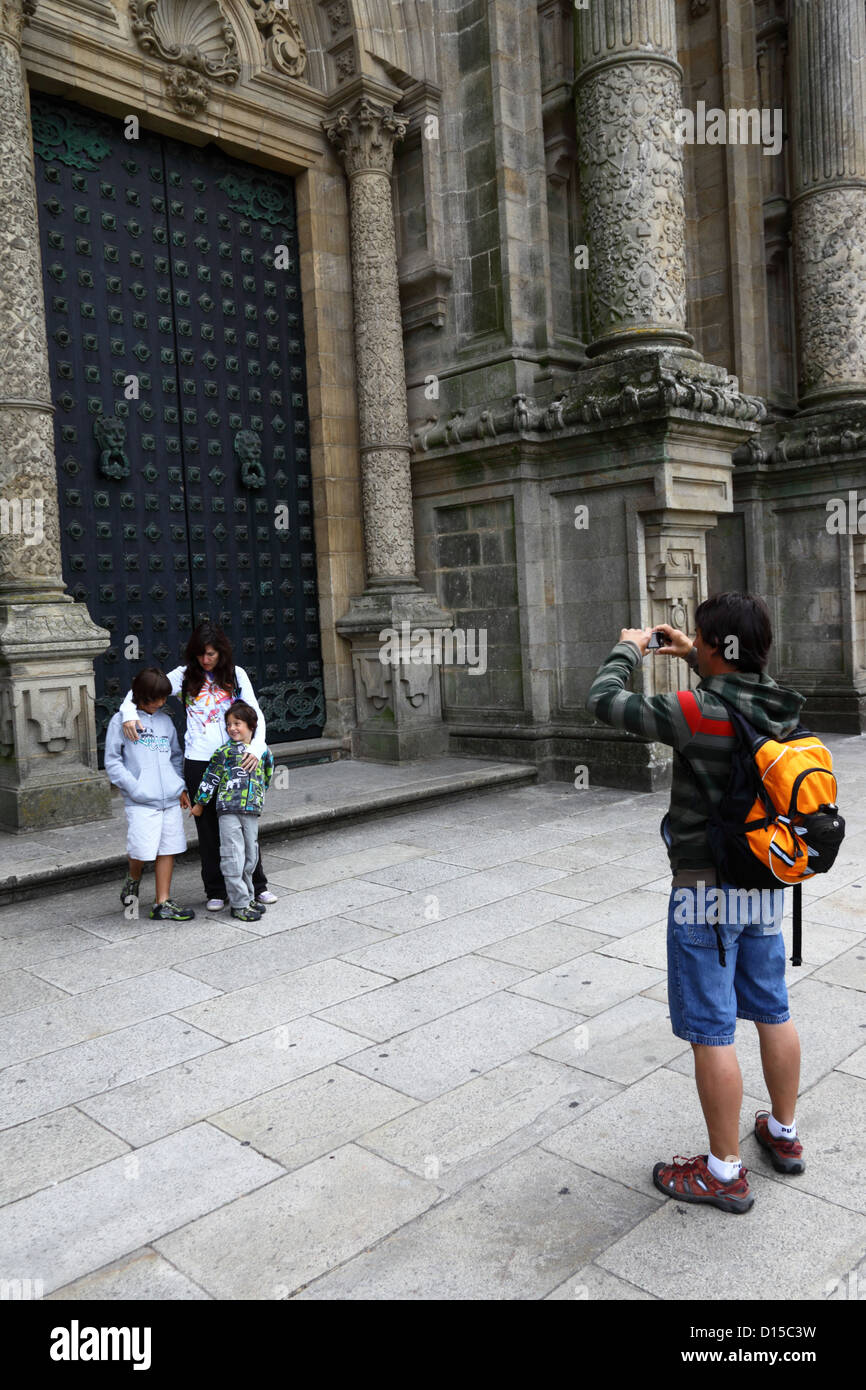 Man taking photo of his family in front of main entrance on west facade of cathedral , Santiago de Compostela, Galicia, Stock Photo