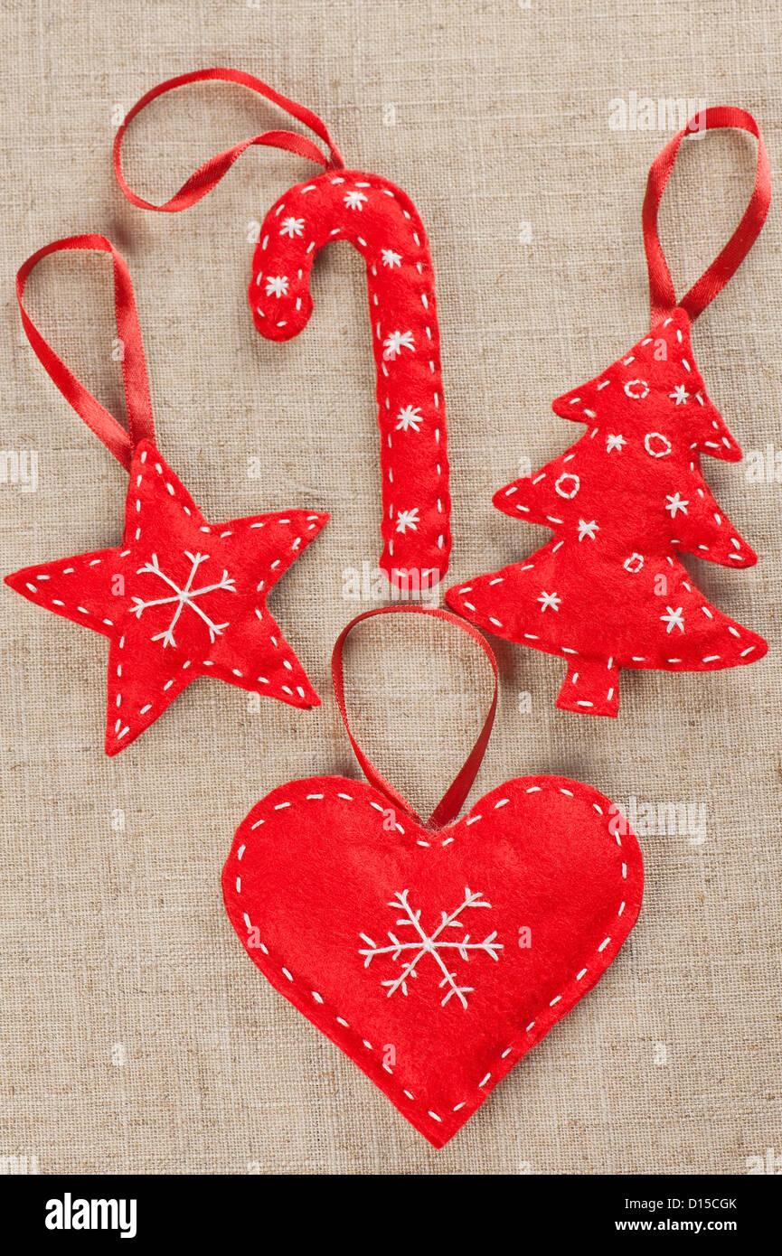 A set of red felt handmade xmas decorations stock photo