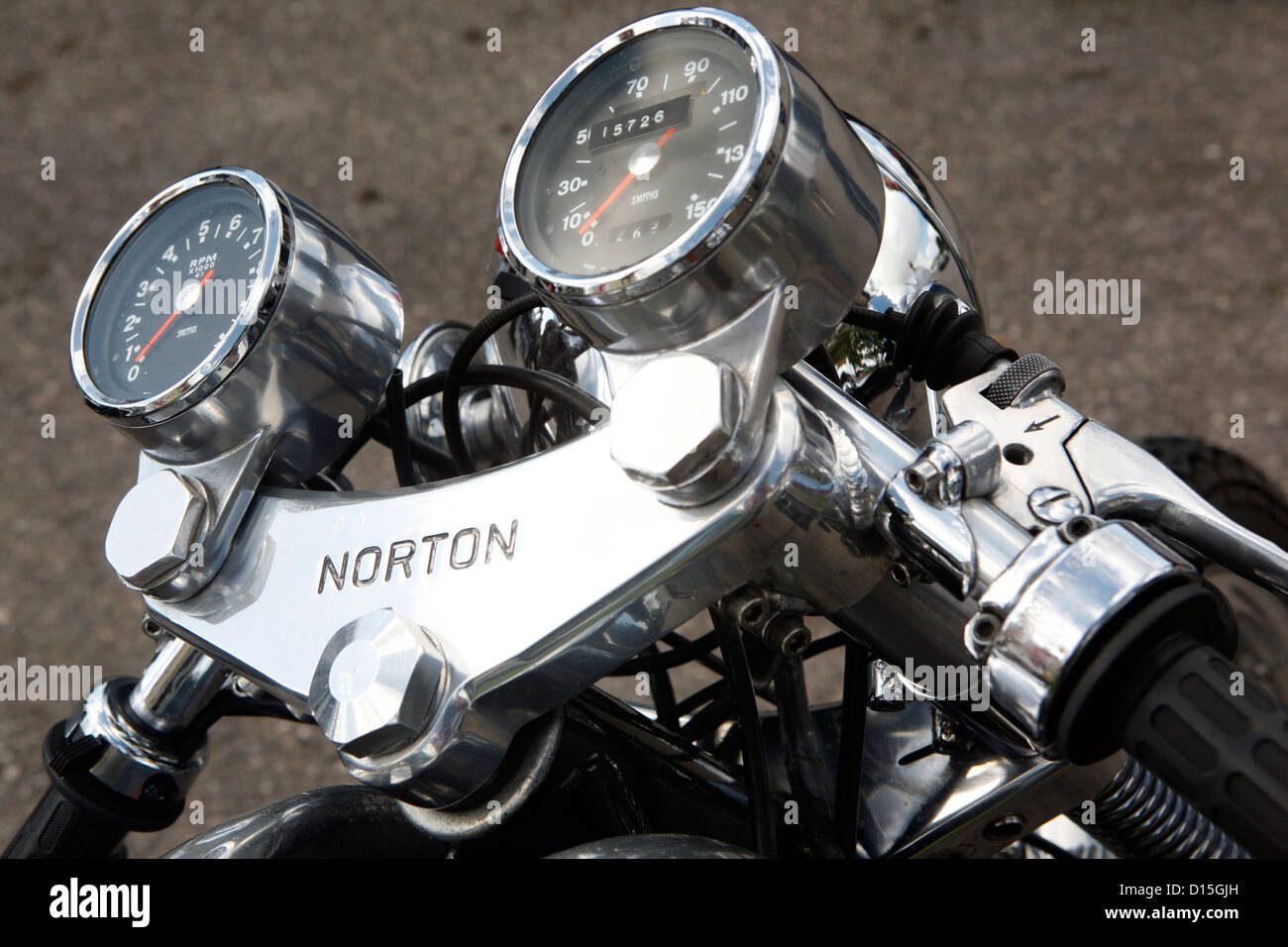 The handlebars and dials of a classic British motorbike. - Stock Image