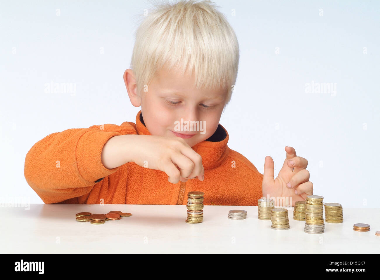 Hamburg, Germany, a boy plays with Geldmuenzen - Stock Image