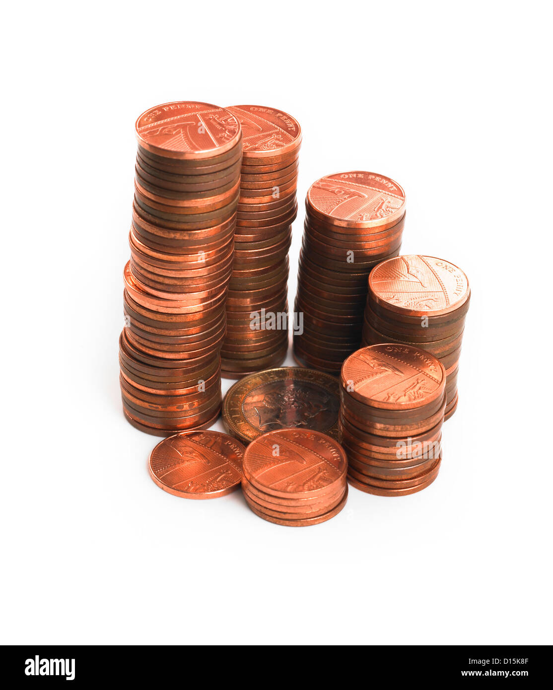 Stacks of one penny coins spiralling around a £2 coin Stock Photo