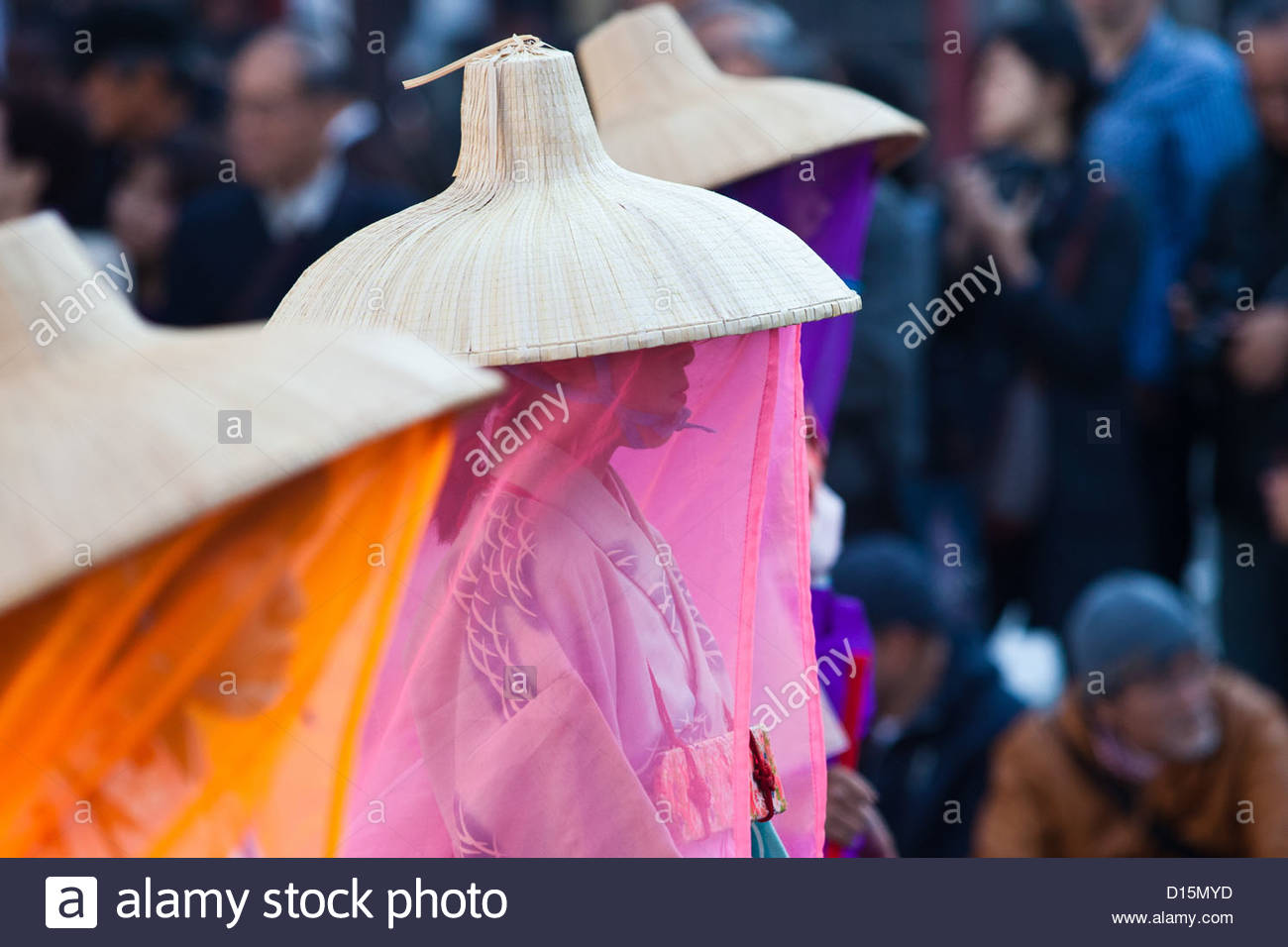 Women with colourful veils walk in the Jidai matsuri parade through Asakusa, Tokyo. Stock Photo