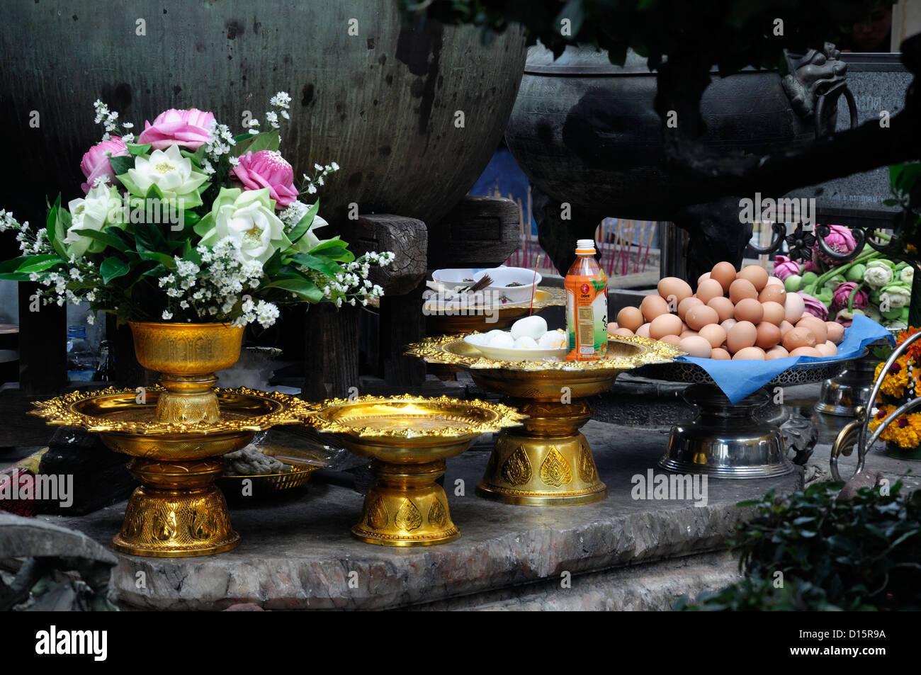 Grand Palace Bangkok Thailand Wat Phra Kaew Temple of the Emerald Buddha gold plate platters patten food offerings - Stock Image
