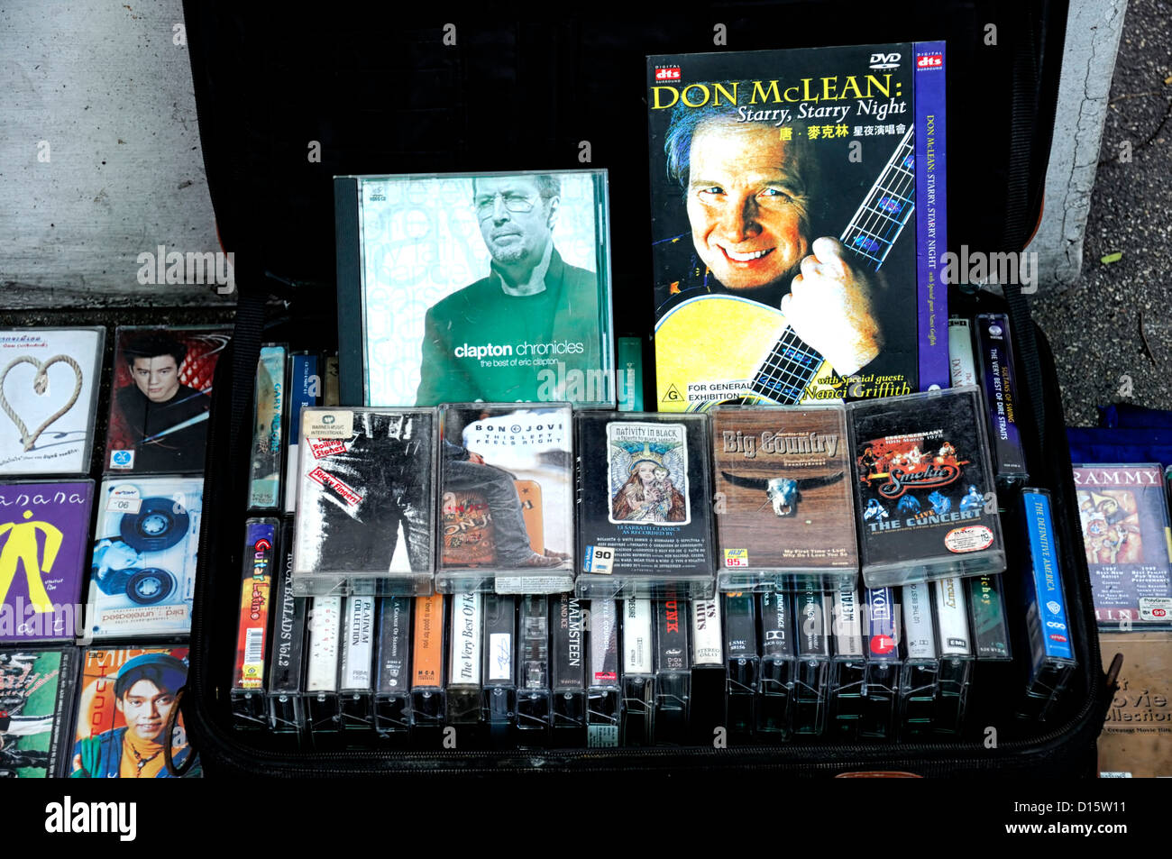 old cassette tapes on sale at a flea market street vendor bangkok thailand - Stock Image