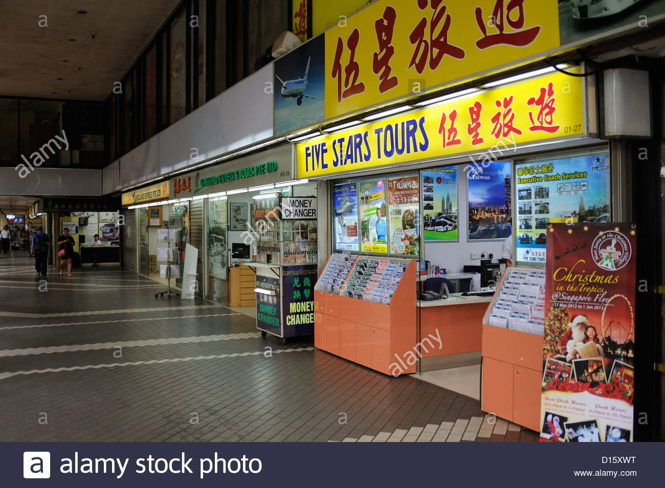 Singapore - Golden Mile Concourse with tour companies operating buses to Kuala Lumpur. - Stock Image