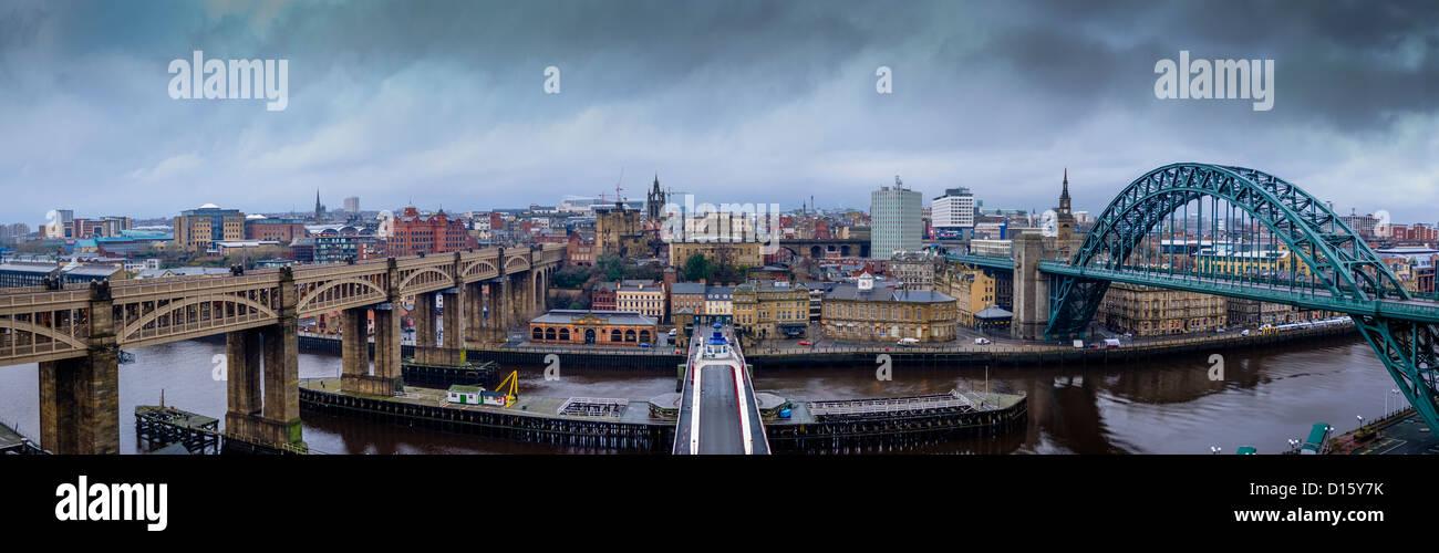 Newcastle-upon-Tyne skyline. Stitched panorama featuring The High Level Bridge, The Swing Bridge and The Tyne Bridge. Stock Photo
