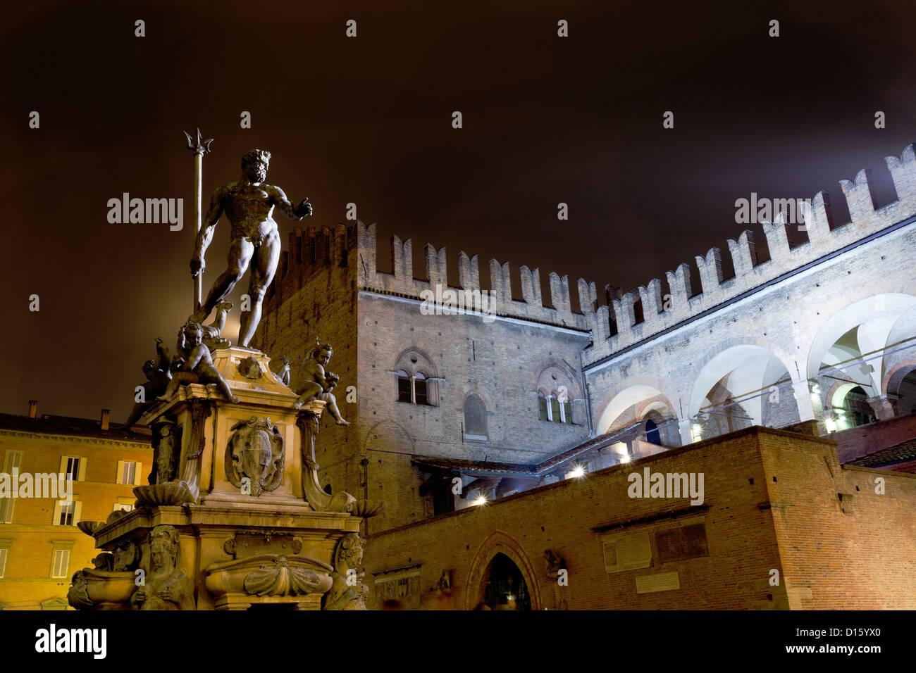 Fountain of Neptune on Piazza del Nettuno in Bologna at night, Italy Stock Photo