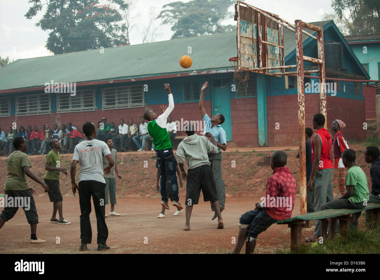 Secondary school students play basketball after classes in Nyeri, Kenya, East Africa. - Stock Image