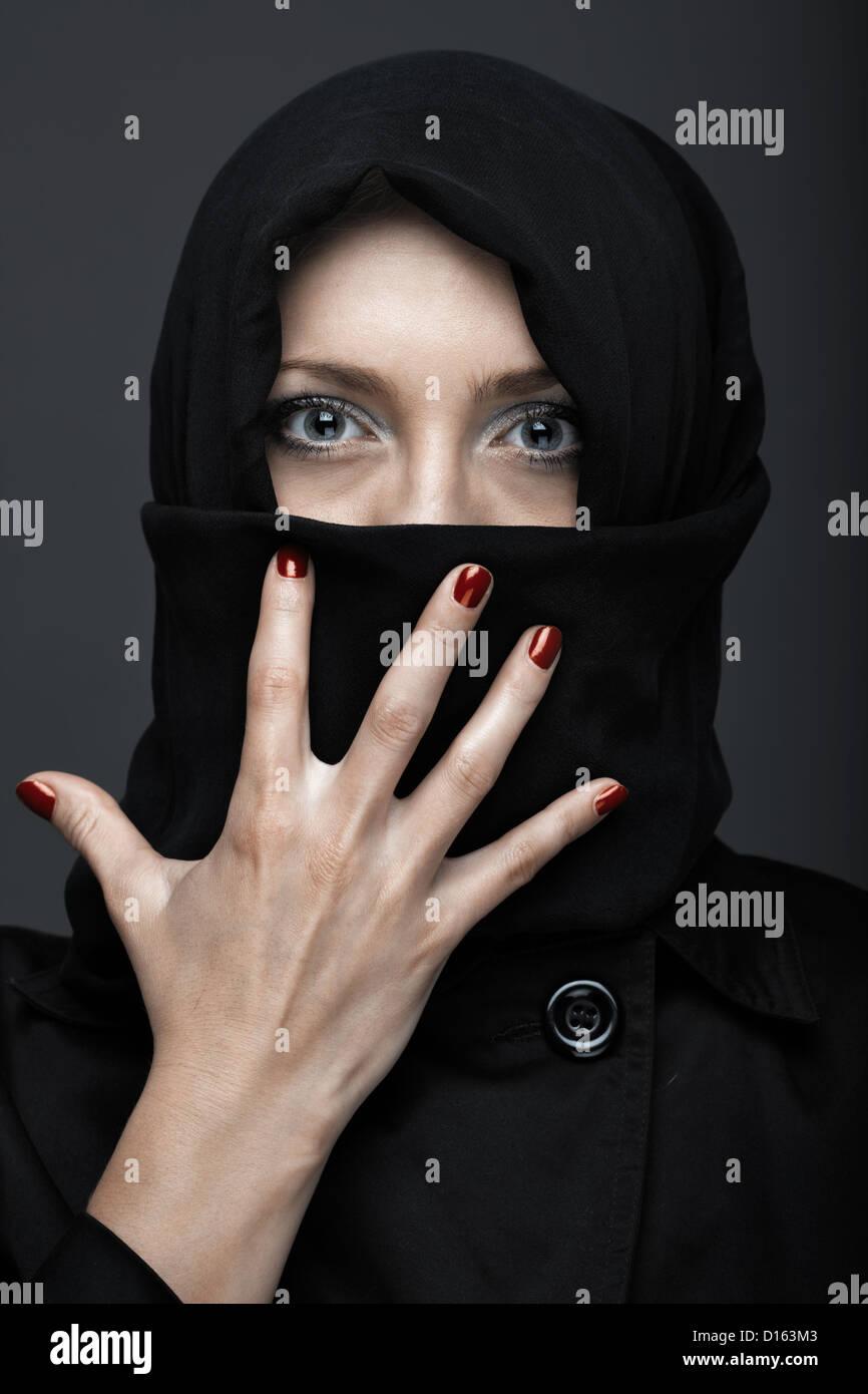 Woman in black ninja dress with manicure Stock Photo
