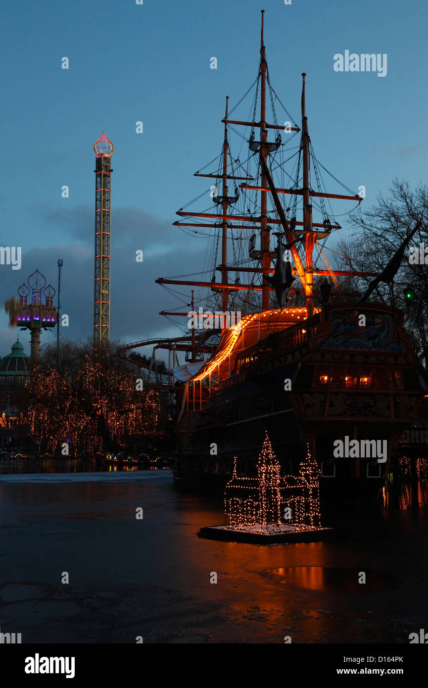 The pirate frigate on the Tivoli Lake at the Christmas market in Copenhagen, Denmark. A family restaurant called - Stock Image